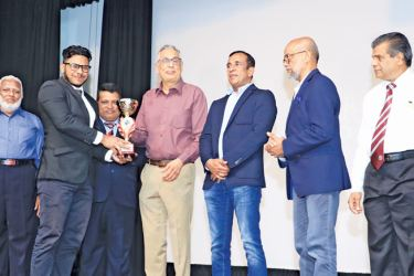 Best Place Kicker 2017 Zaid Sinhawansa receiving award from Phoenix Industries Limited Chairman Aslam Omar. Principal Trizviiy Marikkar, Melbourne Metal Private Limited CEO / Chairman Mohamed Ramzy , Board of Governors Chairman Fouzul Hameed, Rugby Committee Chairman M.S.M. Mazeer and BOG Sports Committee Chairman M.S.M. Faiz were also present. Pictures by Ruzaik Farook