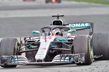 Mercedes' British driver Lewis Hamilton wins the Formula One Russian Grand Prix at the Sochi Autodrom circuit in Sochi on September 30. AFP