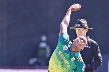 South Africa's Lungi Ngidi bowls during the first One Day International cricket match between South Africa and Zimbabwe at the Diamond Oval in Kimberley on September 30. AFP