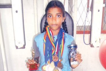 Naleema Lahiruni de Zoysa with her trophies and medals. picture by H L Sunil Shantha – Kalutara Central Special Corr
