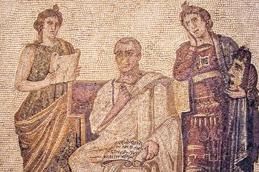Roman mosaic showing Virgil, holding a scroll on his lap, attended by Clio (history), and Melpomene (tragedy). The scroll is open at Aeneid I, line II.