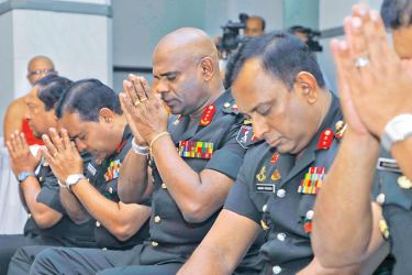 Army Commander Lt. Gen. Mahesh Senanayake and other soldiers engaging in religious observances.