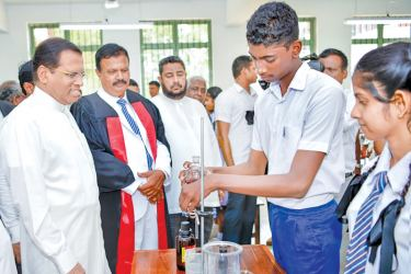 President Maithripala Sirisena who was the Chief Guest at the annual prize giving ceremony of Balapitiya Rewatha National College is seen at the new technological laboratory. Picture by Sudath Silva
