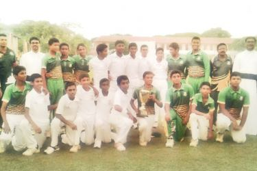 St. Sebastian's College, Moratuwa Under 15 division two cricket team is seen here soon after clinching the All Island Inter Schools Singer Trophy by beating Kiridiwela Central College on bonus points at Royal College grounds Colombo. Front Row Kneeling seventh from left Thihaisha Mendis (Captain) Second Row Standing Second from right Rev. Fr. Priyan Tissera (Prefect of Games), Third from right Kanishka Perera (head Coach and MIC). Second Row Standing Left to right Samith Fernando (Asst. Coach). Third from l