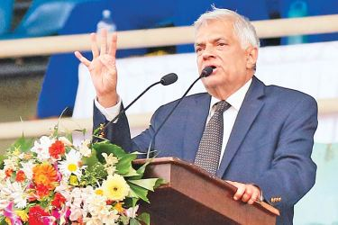 Prime Minister Ranil Wickremesinghe addressing the opening ceremony at the Sugathadasa Stadium yesterday. Pictures by Ranjith Asanka