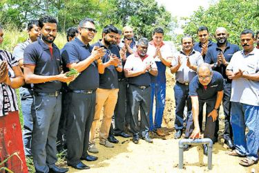 Nimal Tillekeratne CEO of Pan Asia Bank and the staff at the launch of the Drip Irrigation System