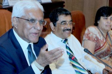 Central Bank Governor Dr Indrajith Coomaraswamy and Senior Deputy Governor Dr.Nandalal Weerasinghe at the press conference. Picture by Saliya Rupasinghe