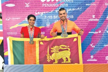 Sonali Wimaladasa and Roshith Perera with their medals