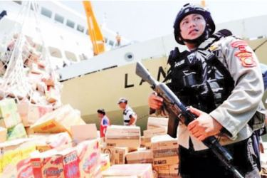 Aid supplies are being guarded by armed police as they arrive in the port.