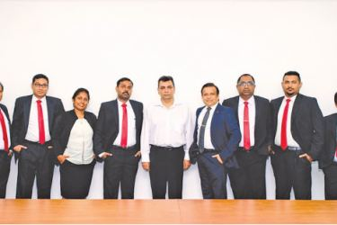 FMI team including Manager, H. L. Dharmasena, Accountant, P. P. Abeydeera, Assistant Manager HR, P. A. N. Nilrukshi, Senior Manager Facilities, S. Dhavalozhan, Managing Director, Phiroze Pestonjee, Director, Manish Shrivastava, Deputy Manager, W. Anura, Assistant Manager New Technologies, D. D. Rukshan Perera, Assistant Manager Corporate Support Services, L. A. W. Mohotti