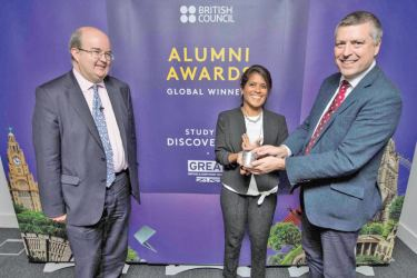 Global winner of the Professional Achievement category, Study UK Alumni Awards 2018, Asha de Vos (centre) receives her award from British Council CEO, Sir Ciarán Devane (right)