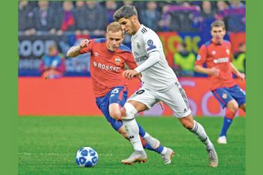 CSKA Moscow's Russian forward Dmitri Efremov (L) and Real Madrid's Spanish midfielder Marco Asensio vie for the ball during the UEFA Champions League group G football match between PFC CSKA Moscow and Real Madrid CF at the Luzhniki stadium in Moscow on October 2. AFP