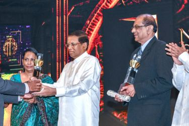 The Golden Jubilee celebrations of the National Science Foundation was held at the BMICH under the patronage of President Maithripala Sirisena on Thursday. The President recognized the services of Prof. C. B. Dissanayake and Prof. R. A. K. L. Dissanayake presenting them with lifetime awards at the ceremony. Minister Dr. Sarath Amunugama and Deputy Minister Karunaratne Paranavithana were also present. Picture by Sudath Malaweera.