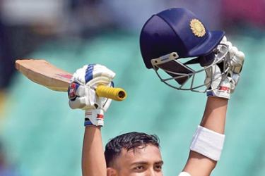 Prithvi Shaw celebrates his century on Test debut against West Indies at Rajkot.