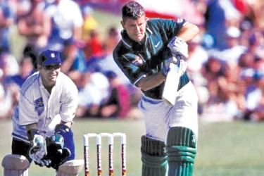 Martin Crowe batting with four stumps.