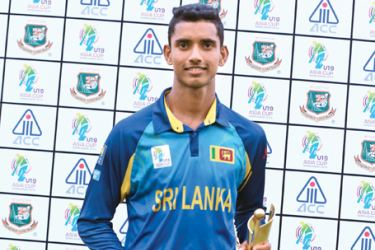 Sri Lanka under 19 cricketer Nawanidu Fernando with his Man of the Match award for his match-winning century against Afghanistan at Dhaka yesterday.