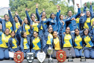 The victorious Musaeus College rowing team with their trophies. Picture by Saman Sri Wedage