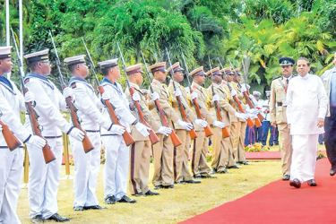 President Maithripala Sirisena was accorded a Guard of Honour by Seychelles President Danny Faure on arrival at the State House in Victoria yesterday. Picture by Sudath Silva