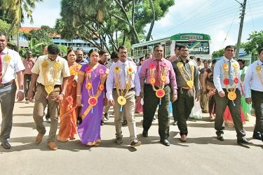 Teachers being brought to the school premises.