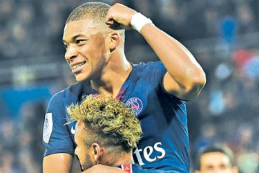 Mbappe was in unstoppable form as he put four goals past a stunned Lyon. AFP