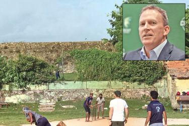 Kevin Roberts the new CEO of Cricket Australia (at the non-striker's end) plays a game of cricket with local lads inside the Galle Fort. Insert: Kevin Roberts.