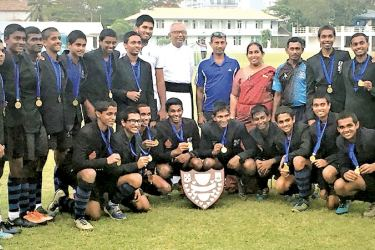 The winning STC U-20 team with the Chaplain Rev. Amal Fernando, coaches and the Neville De Alwis Challenge Shield.
