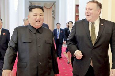 North Korea's leader Kim Jong Un with US Secretary of State Mike Pompeo (R) at the Paekhwawon State Guesthouse in Pyongyang. - AFP