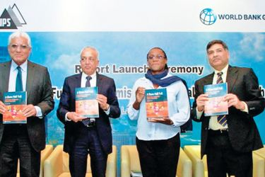 Central Bank Governor, Dr. Indrajith Coomaraswamy, Minister of Development Strategies and International Trade, Malik Samarawickrama, World Bank Country Director, Dr. Idah Pswarayi-Riddihough and World Bank Lead Economist and lead author of the report, Sanjay Kathuria at the launch of 'A Glass Half Full: The Promise of Regional Trade in South Asia' report in Colombo (Picture by Indika Handuwala)