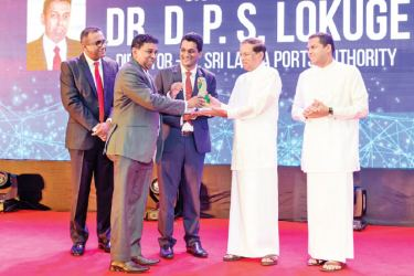 Dr. Prasanna Lokuge Director Information Systems of Sri Lanka Ports Authority (SLPA) receivies the CIO of the Year Award from His Excellency the PresidentMaithripala Sirisena. Minister of  Telecommunication, Digital Infrastructure and Foreign Employment Harin Fernando and President, CSSL Yasas Abeywickrama are  also in the picture.