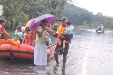 The Navy assists in rescue operations during the recent flash floods.