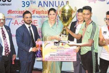 Captain  of  Exporlanka football Team M Shazny receivs the Cup Champion trophy from the chief guest. Pictures by Sudath Nishantha