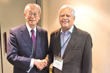 Minister Dr. Sarath Amunugama with Koji Omi, Founder and Chairman of the Science and Technology in Society Forum