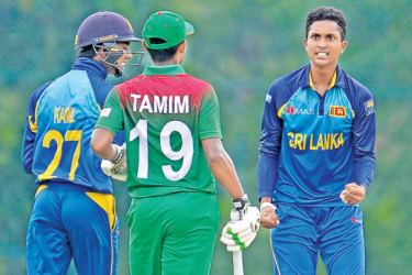 Rohan Sanjaya who took three wickets for 29 runs celebrates the wicket of Hasan Tamim for 25 in the fourth under 19 ODI cricket match played at Katunayake yesterday. The match ended in a no-result due to rain.