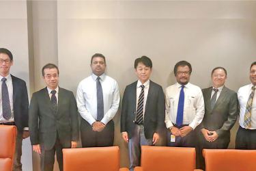 LAUGFS Holdings Chairman, W. K. H. Wegapitiya and Group Managing Director, Thilak De Silva  with the Yamaha Motor Power Products Co.Ltd. Senior General Manager, Jun Nakata and other senior management