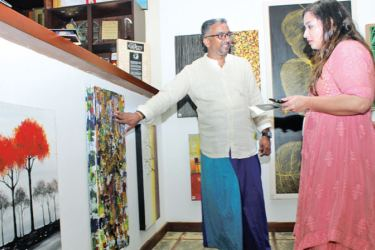 Stasshani Jayawardena at the gallery opening with Chef Dimuthu. Pictures by Saliya Rupasinghe