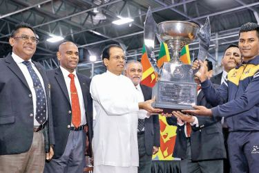 The captain of the Defence Services Games champions Army receiving the overall trophy from president Maithripala Sirisena