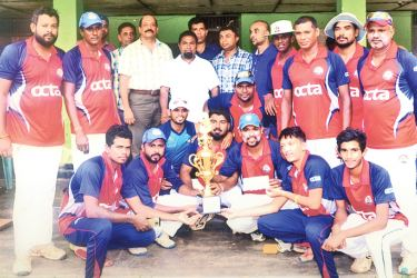 The Champion Chilaw Cricket Club team is seen here with the trophy.