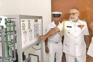 Navy Commander Vice Admiral Sirimevan Ranasinghe opening a Reverse Osmosis (RO) plant.