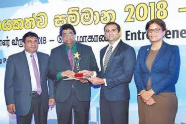 Bopitiya Auto Enterprises was adjudged as Best Entrepreneur of the Year 2018 and founder of Bopitiya Auto Enterprises, Jude Rodrigo receiving the award from Chairman,  NEDA, Daskshitha Bogollagama. Country Director at WUSC, Esther McIntosh and President NCCSL, Sujeeve Samaraweera look on. Picture by Sulochana Gamage