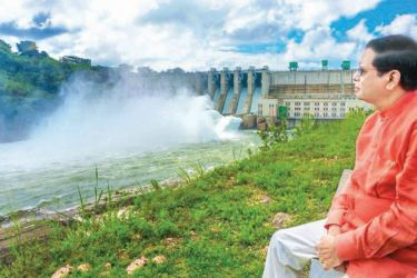 President Maithripala Sirisena observes the Moragahakanda Reservoir after opening its sluice gates last morning. The Moragahakanda Reservoir comes under the giant Moragahakanda - Kalu Ganga Multi-Purpose Development Project. Picture courtesy President's Media Division