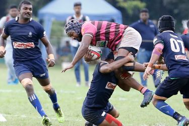 A Havelocks player is well tackled by a Police player in their Dialog 'A' division league Rugby match played at Police Park yesterday which Havelocks won 31/26 Picture by Samantha Weerasiri