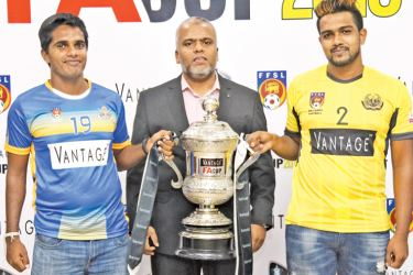 Army team captain Sajith Kumara (on  Left) and Saunders team captain Chanuka Eranga are seen here with the trophy.