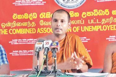 CAUG Convenor Ven. Thanne Gnanananda Thera, Ven. Suriyawewa Sumana Thera and Achintha Divanjana at the media conference yesterday.