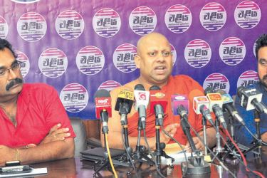 Shriyantha Mendis, Ven. Medagoda Abhayatissa Thera and Sudath Rohana, at the press conference yesterday.  Picture by Thushara Fernando