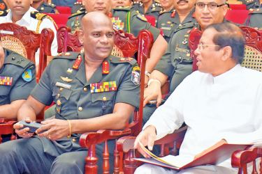President Maithripala Sirisena was the Chief Guest at the first ever symposium of the Sri Lanka Army Women's Corps (SLAWC) at the BMICH yesterday.Here, President Sirisena in conversation with Army Commander Lt. Gen. Mahesh Senanayake. Picture by Gayan Pushpika
