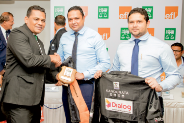 M.T.M. Nawushad - chairman and M. T. M. Naufal - MD of Kandurata Group handing over rain Jacket and stockings to Nizam Jamaldeen - president of SL Rugby Rferees Society.