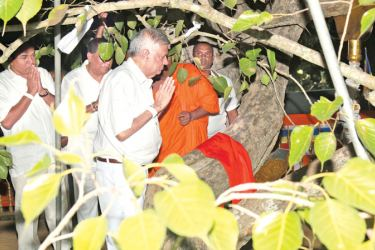 Prime Minister Ranil Wickremesinghe who toured in the flood affected areas of the Northern Province also  toured the  Anuradhapura Sacred City and paid homage to the Sri Maha Bodhi. The Prime Minister also paid a  courtesy call on the Chief Incumbent of the Atamasthanaya Most Ven. Dr. Pallegama Sirisumana Dhammarakkitha Sirinivaasa  Nayaka Thera. The Prime Minister paying homage. Picture by Hirantha Gunatilleke