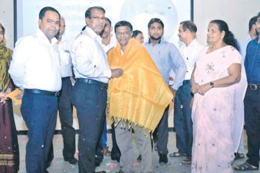 K.Arulpragasam being felicitated. Picture by I.L.M.Rizan