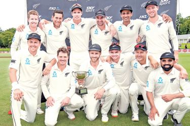 New Zealand celebrate winning the two-Test match series 1-0 against Sri Lanka during day five of the second cricket Test match at Hagley Park Oval in Christchurch on Sunday. - AFP
