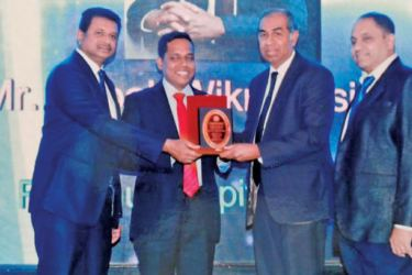 Ruhunu Hospital (Pvt.) Ltd Chairman, Deepal Wickremasinghe receiving the award for 'Best Hospital Brand' in the Southern Province by the Galle Chamber of Commerce